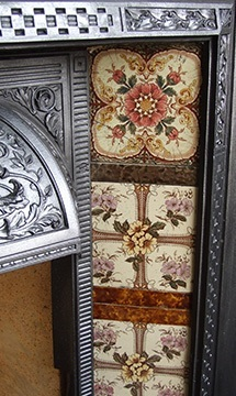 decorative tiles and cast iron fireplace