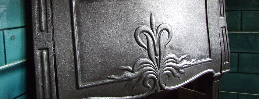 detail of restored cast iron fireplace