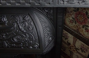 detail of cast iron fireplace